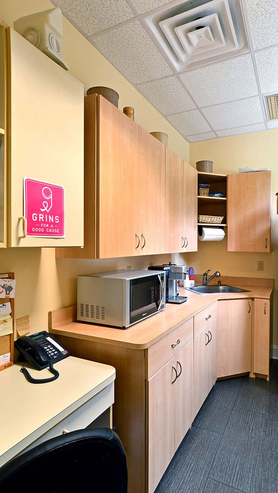 Medical office lunch and break room with custom cabinets and furniture