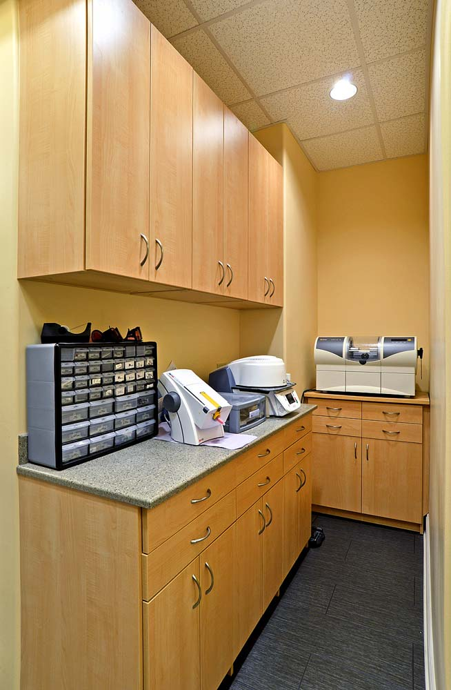 Work room with custom built cabinets in medical office