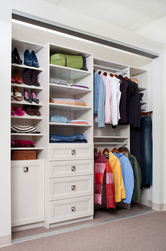 Reach-In closet with angled shoe shelves and double hanging