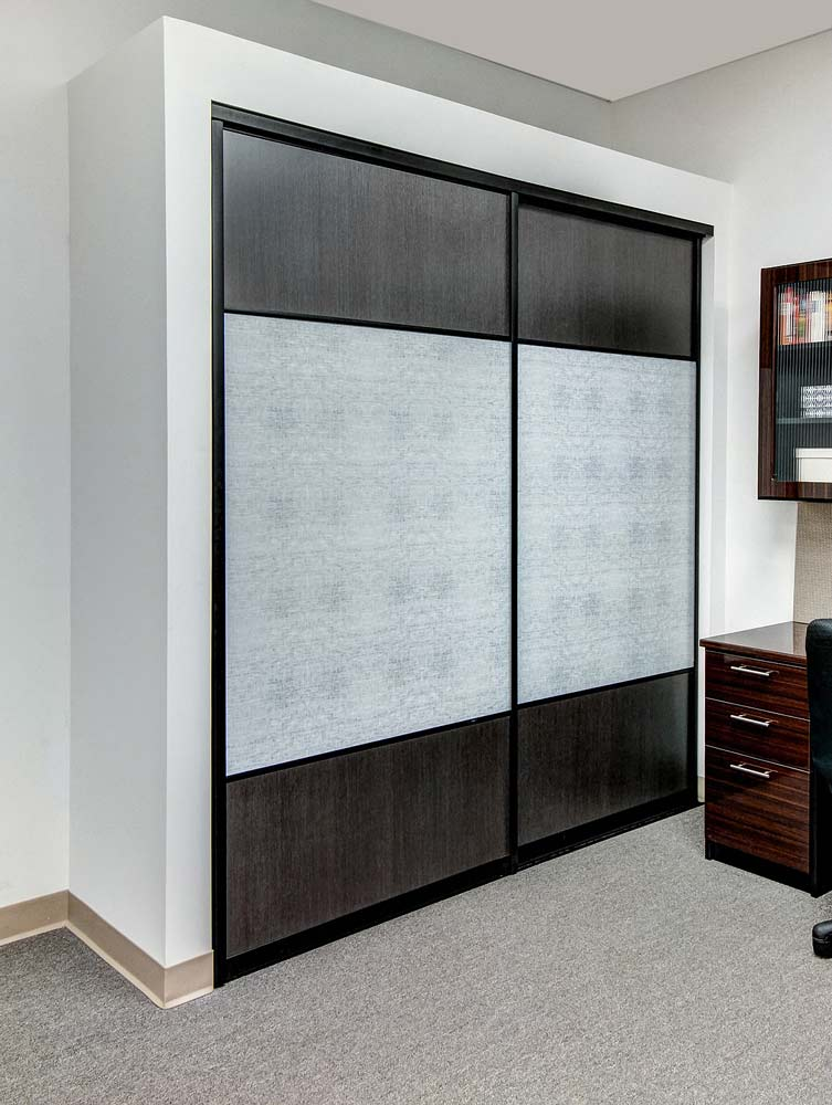 Reach-in closet with sliding doors and glass inserts