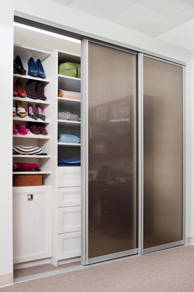 Reach-in closet with glass sliding doors