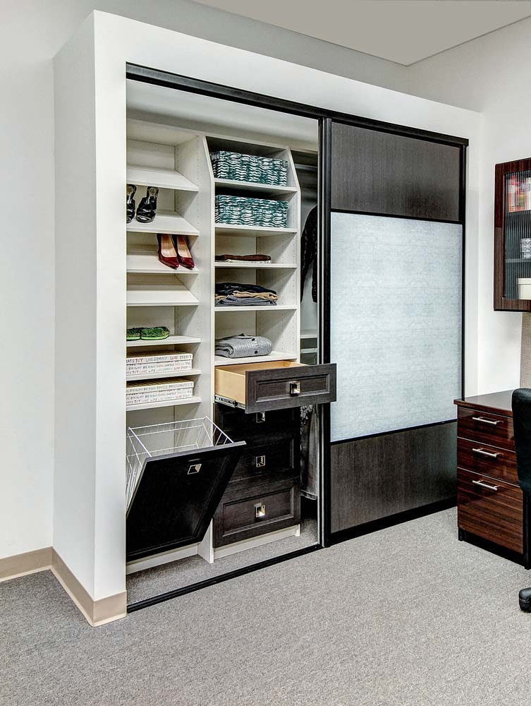 Sliding doors open to reveal organized reach-in closet storage