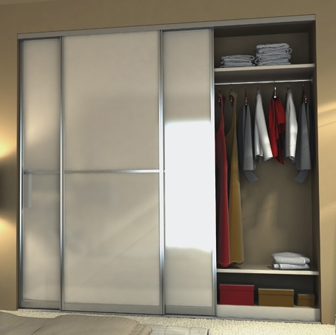 Sliding doors on bedroom closet open to organized space