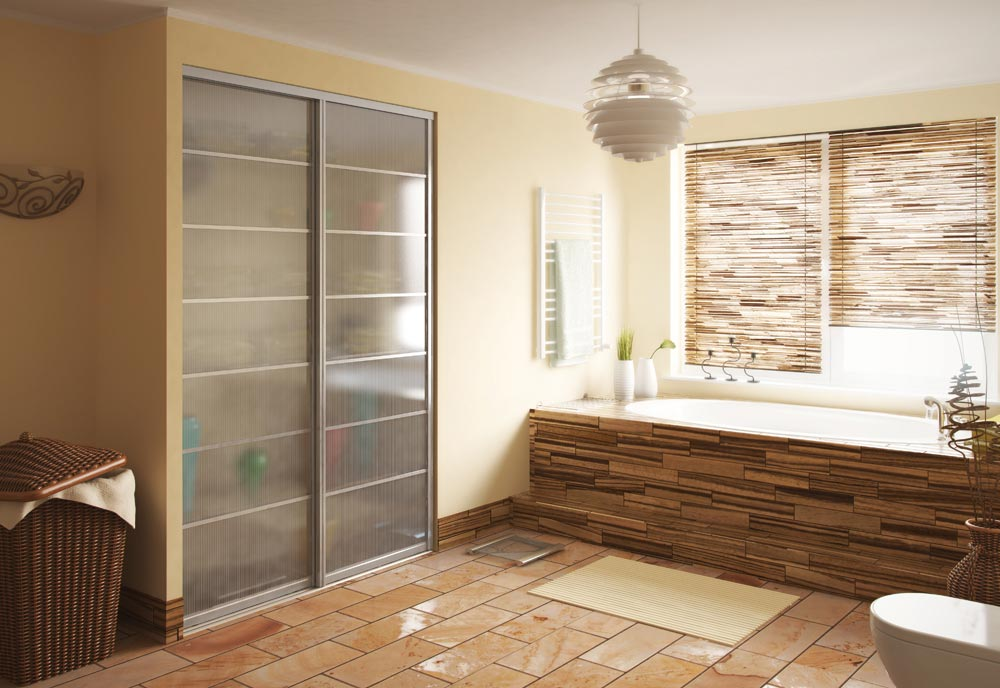 Bathroom sliding doors with see through glass panels on linen closet