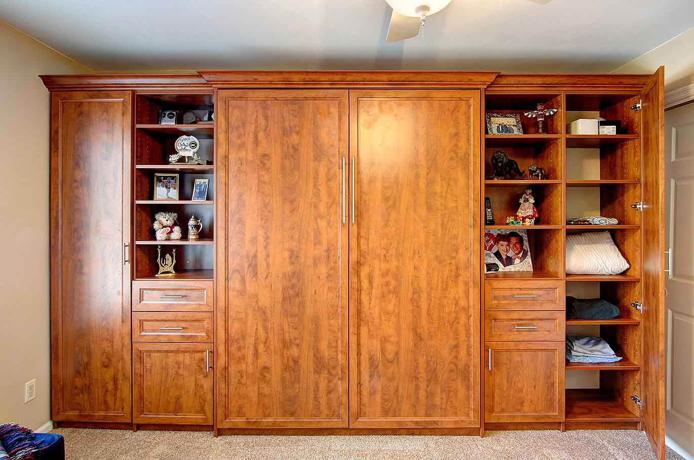 Custom furniture wall unit piece with queen-sized Murphy Bed vertically stored