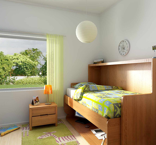 Space saving hideaway bed with matching cabinet in child's room