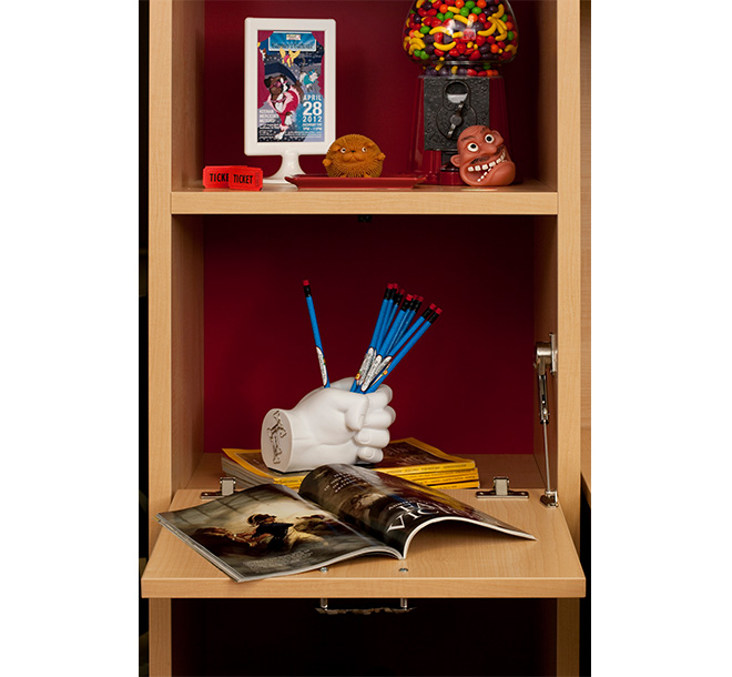 Cubbie storage space with lift up doors and magazines neatly displayed