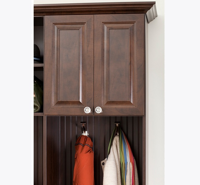 Mudroom with accessory hooks holding jackets