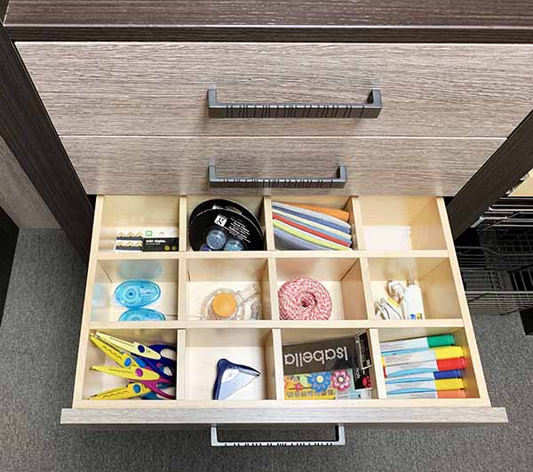 Craft room with supplies organized in drawer inserts