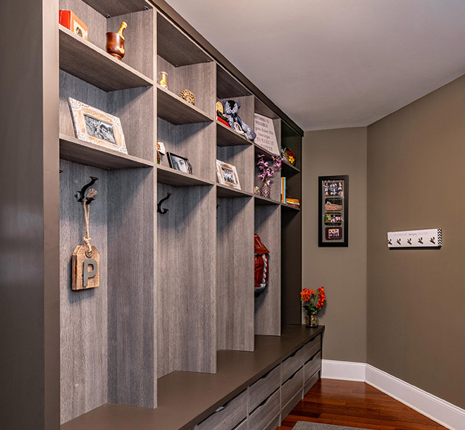 Mudroom designed with cubbies and custom storage for each family member