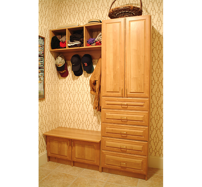 Custom wood cabinets built in mudroom with bench and cubbies