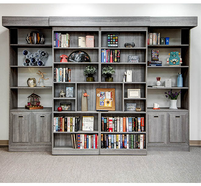 Custom Murphy bed concealed behind a sliding bookcase