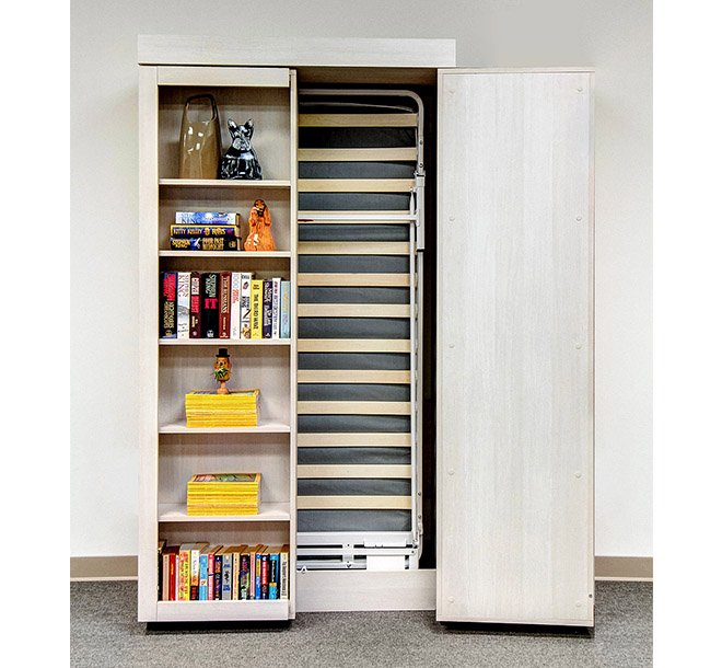 Twin sized Murphy bed frame behind hinged bookcase