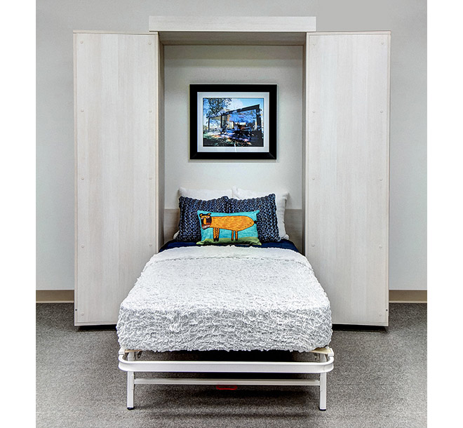 Custom furniture hinged doors open with a pull down bed neatly made