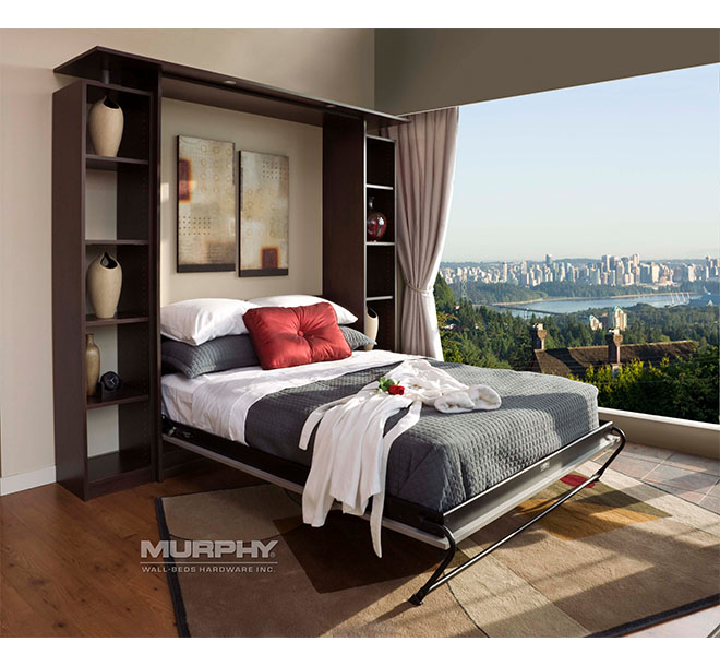 Custom Murphy bed open in guest room with a beautiful view of the city