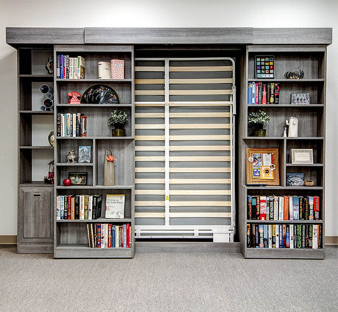 Custom Murphy Bed frame behind a sliding bookcase