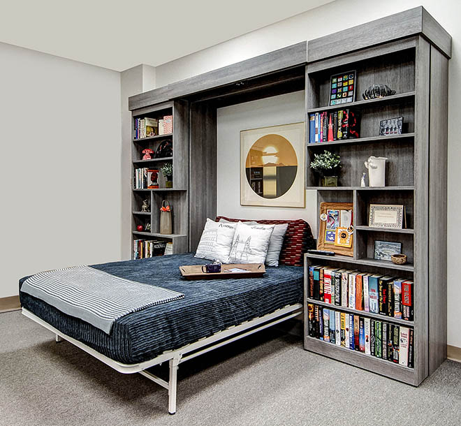 Custom Wall bed pulled down from behind sliding bookshelf