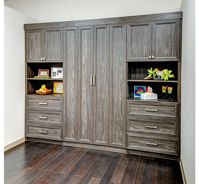 Murphy bed built into wall unit with bifold doors
