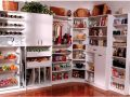 Built in pantry design with rounded corner shelving and Lazy Susan
