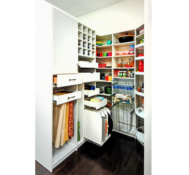 Pantry with vertical sliders pulled out storing tablecloths and trays neatly