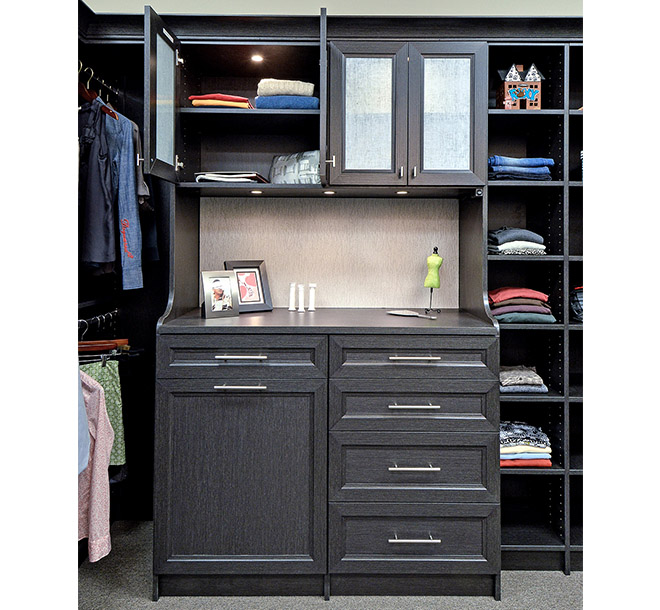 Walk-in closet cabinet with countertop and recess puck lighting