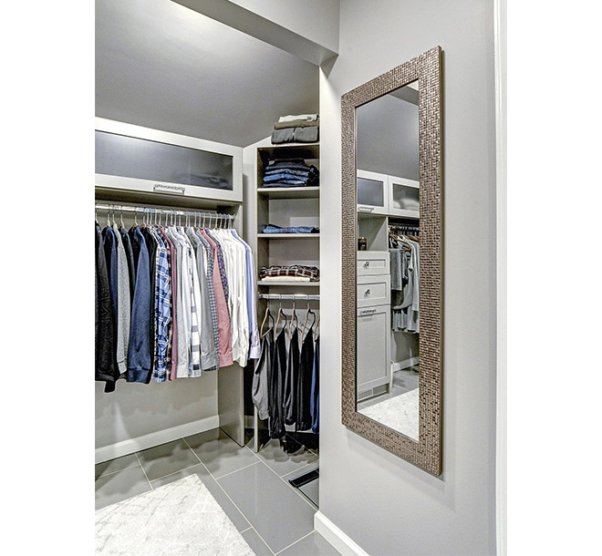 Walk-In closet with angled walls and ceilings