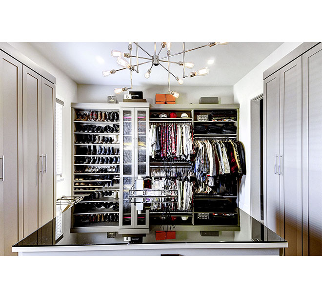 Walk-In closet with shaker style doors and shoe shelves