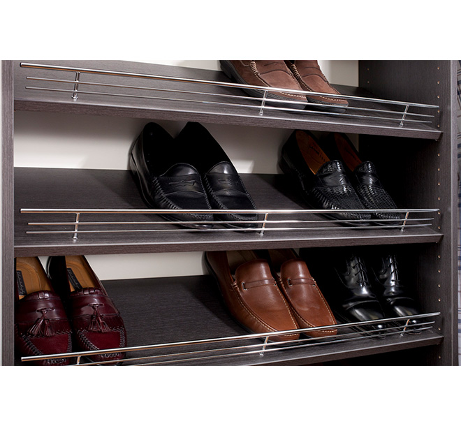 Angled shelves filled with shoes and shoe fences