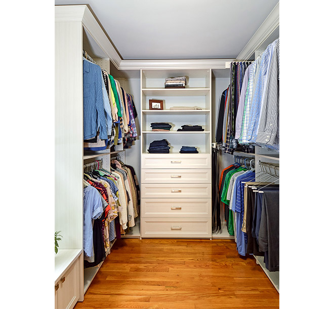 Drawers and shelves with folded clothes and double hangers on each side