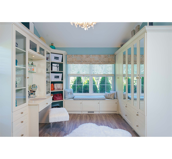 Chic style walk-in closet with beautiful cabinets finished in an almondine color