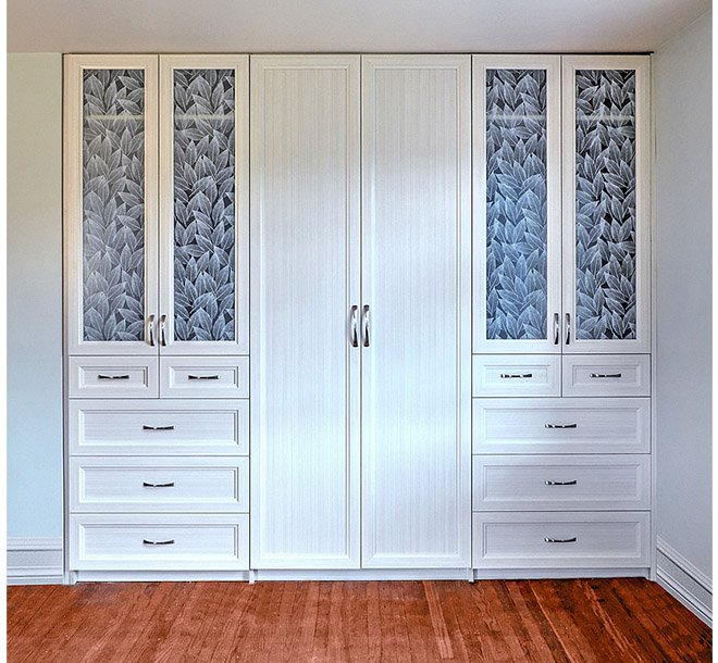 Built in custom wardrobe closet with hardwood floors