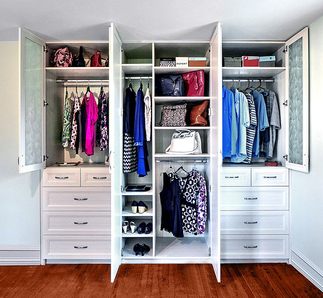 Wardrobe Closet with womens clothing organized and hung neatly on hangers