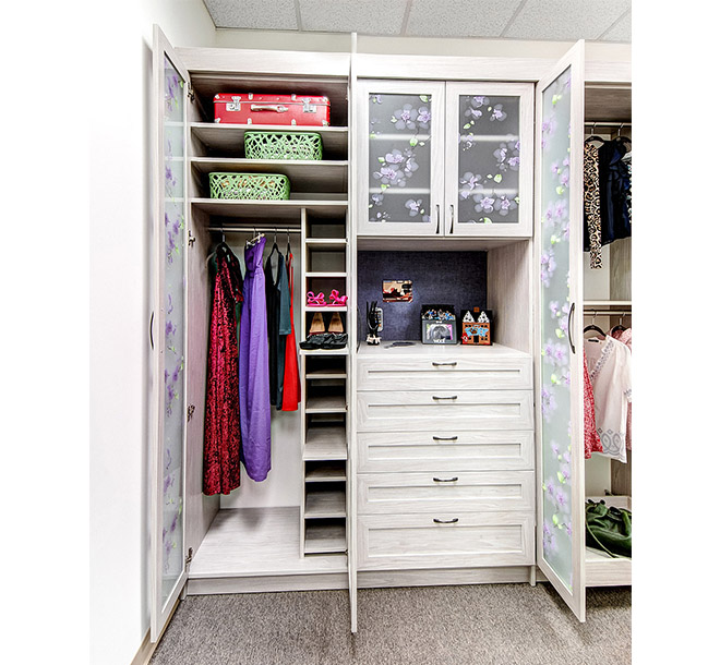 Custom pull out closet shelving in wardrobe cabinet