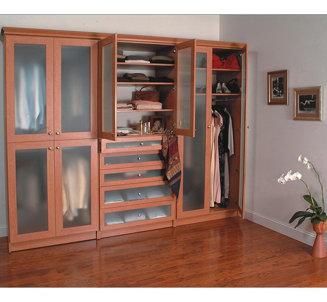 Classic style wardrobe with glass doors open to reveal items neatly stored
