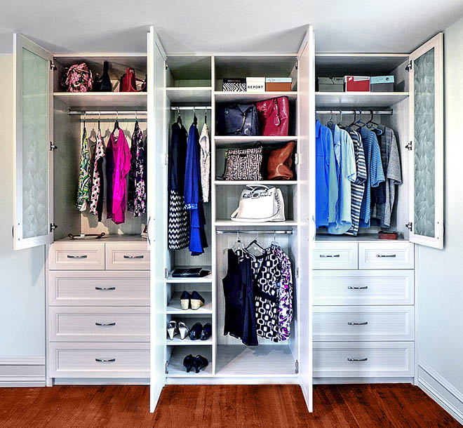 Custom wardrobe closet with clothing and wardrobe items neatly orgaznied