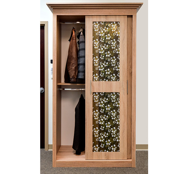 Custom wardrobe storing jackets and coats on double hanging rods