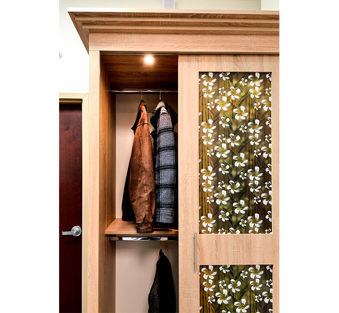 Jackets hung neatly in a custom wardrobe closet with sliding doors