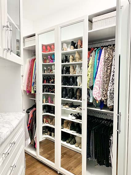 Closet cabinet with mirrored doors open