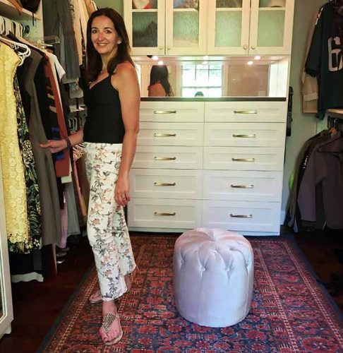 Happy customer smiling in her organized closet
