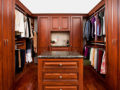 Woman custom walk-in closet with bench seat and center island
