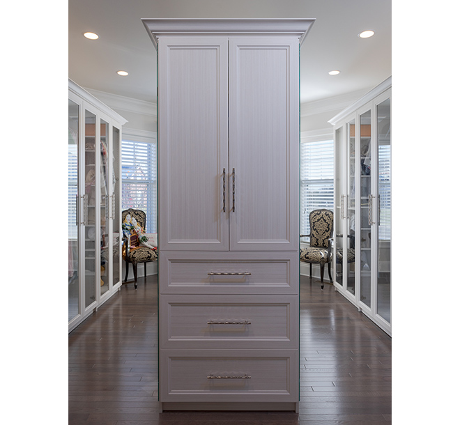 traditional walk-in closet with center island