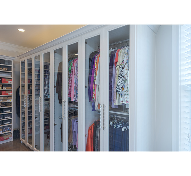 Closet cabinet with beautiful see through glass doors