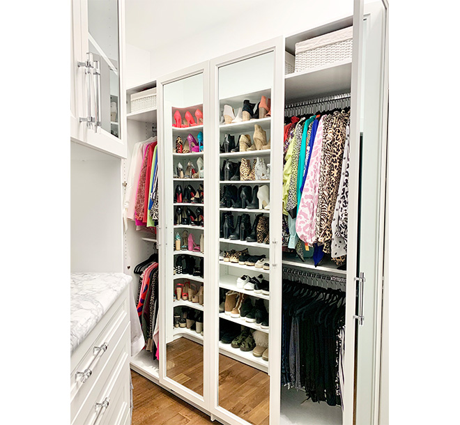 Walk in closet with mirror doors and shoe storage