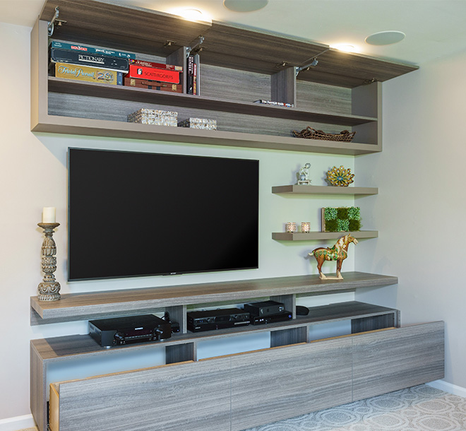 Entertainment and Media Center with additional storage cabinets built in above
