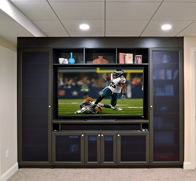 Media center design with custom shelves and glass door inserts