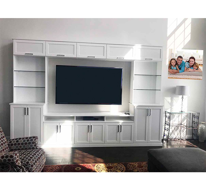 Custom wall unit with glass shelves and additional storage compartments