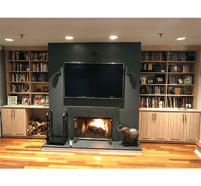Media Center and wall unit with fireplace and books organized