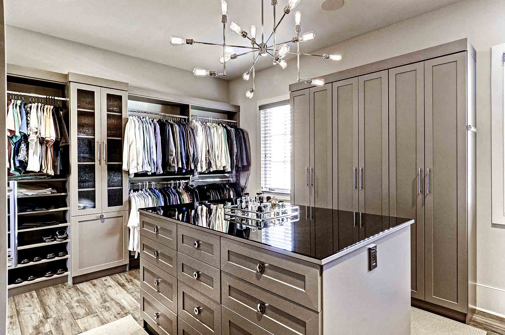 Organized walk-in closet with center island