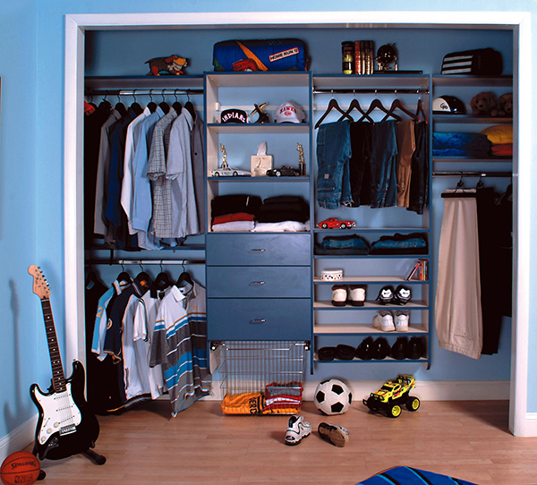 Organized boys reach in closet with sports gear and guitar