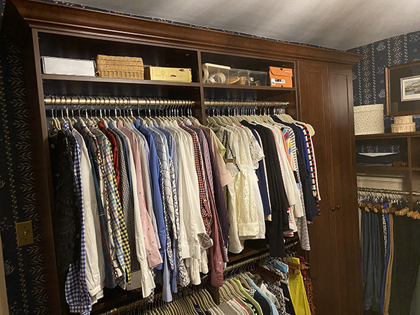 Clothes on double hanging in historical home closet